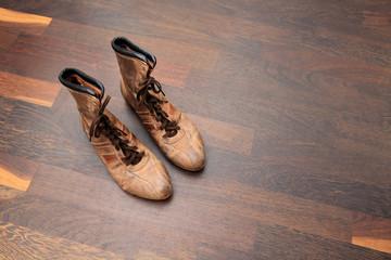 retro style baseball boots on parquet