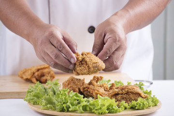 Chef presented Fried chicken, burger and french fries