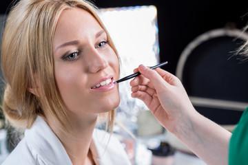 Beauty bride during wedding makeup