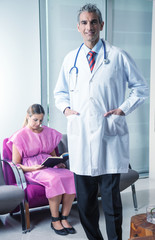 Doctor ready to receive female patient in the hospital waiting r