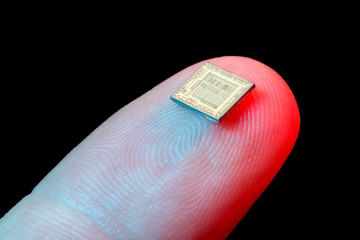 Silicon microchip on fingertip