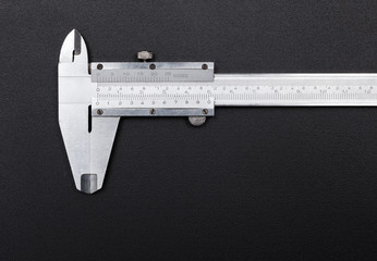 Caliper on black background