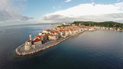 Aerial panoramic view of old city Piran, flight with birds