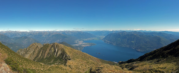 panoramic view on the swiss mountains and on the lake maggiore