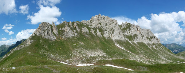 Mountain peak under a blue sky in Switzerland