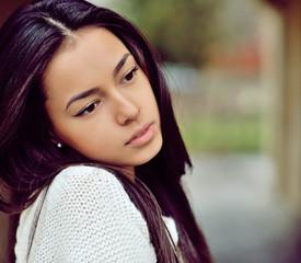 Beautiful sad girl outdoor portrait