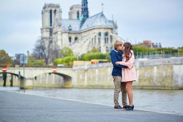 Couple near Notre-Dame de Paris