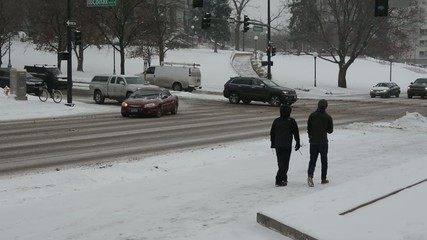 Pedestrians walking in the snow during a blizzard