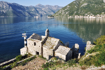 View of old Church at Adriatic Coast with mountains