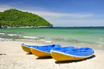 Canoe on sand beach with clear sky, Thailand