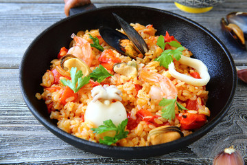 Paella with squid mussels