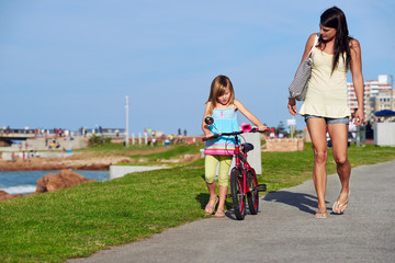 riding bike beach child