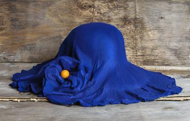 blue felt hat with flower