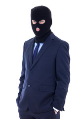 man in business suit and black burglar mask with hand extended t