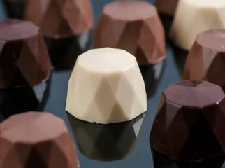 chocolate bonbons on black base