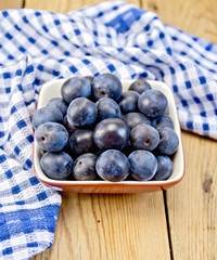 Plum blue in bowl on board with napkin