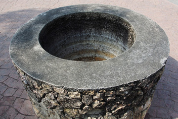 A stone water well
