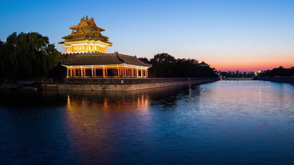 The scene of sunset at corner tower of Palace Museum, Beijing,