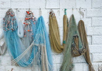 Fishing nets hanging on the wall