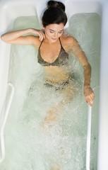 Woman having procedure in a  bathtub