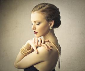 Classy woman wearing pearls