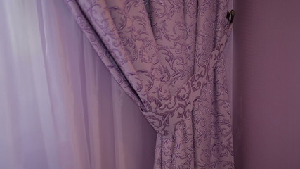 Beautiful purple curtains in the interior of the room