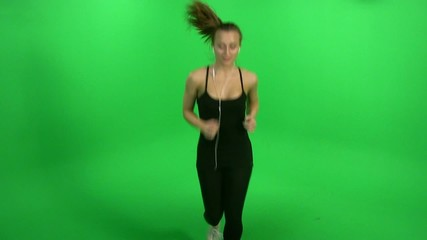 Girl run on green screen and listening music