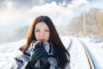 Girl walking along old railroad