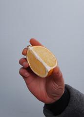 Hand hold citrus slice