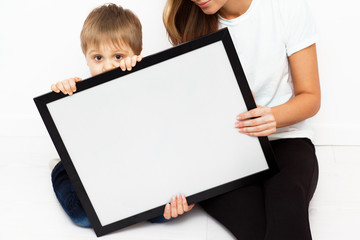 Mother with child holding a frame