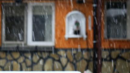 Snow falls in the yard