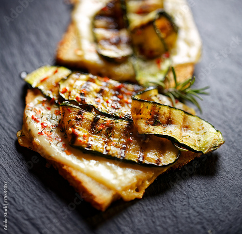 Tuinposter Snack Bruschetta with grilled zucchini and cheese