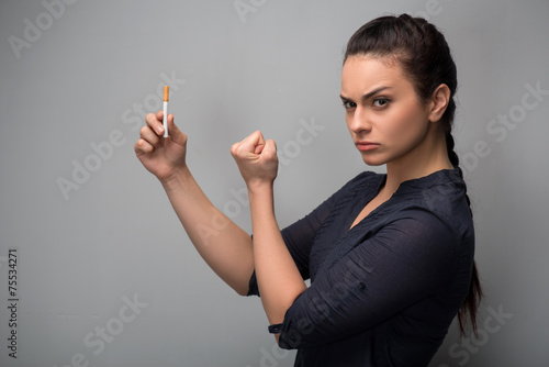 Addiction. Closeup of young woman determined girl holding cigare - 75534271