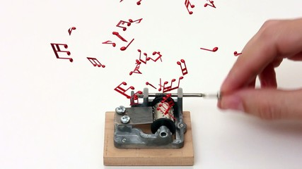 music notes flying out of music box – white background