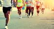 marathon athletes legs running on city road - 75534879