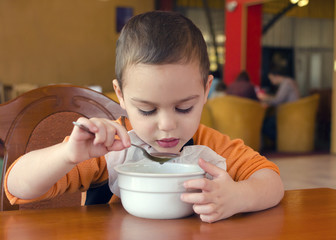 Child eating in restaurant