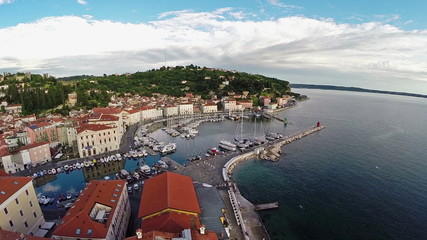 Flight over old city Piran, aerial panoramic view, Slovenia