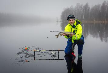 Men fishing pikes on ice