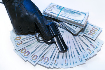 gloved hand with a gun with money