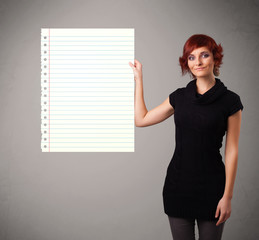 Young woman holding white paper copy space with diagonal lines