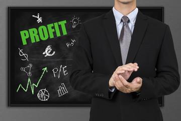 businessman make profit with blackboard