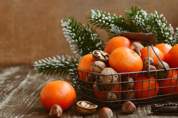 Xmas decoration with tangerines with copy space on wood