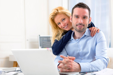Portrait of Young attractive couple using laptop