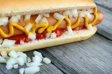 Hot dog closeup with yellow mustard and ketchup