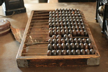 Old wooden retro abacus on the table