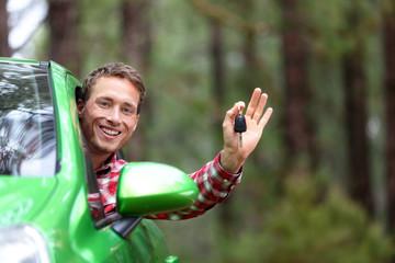 Car driver showing car keys happy