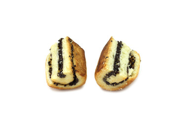 bun with poppy seeds cut into two pieces on a white background