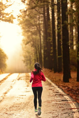 Athlete running on road in morning sunrise