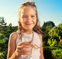 Child holding glass water