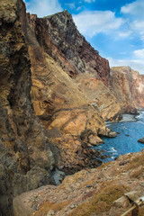 Yellow-red rocks on an ocean coast, Madeira, Portugal